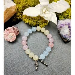 """Bracelet avec pierres fines sur cordon élastique et plume """"Cocon d'amour"""""""